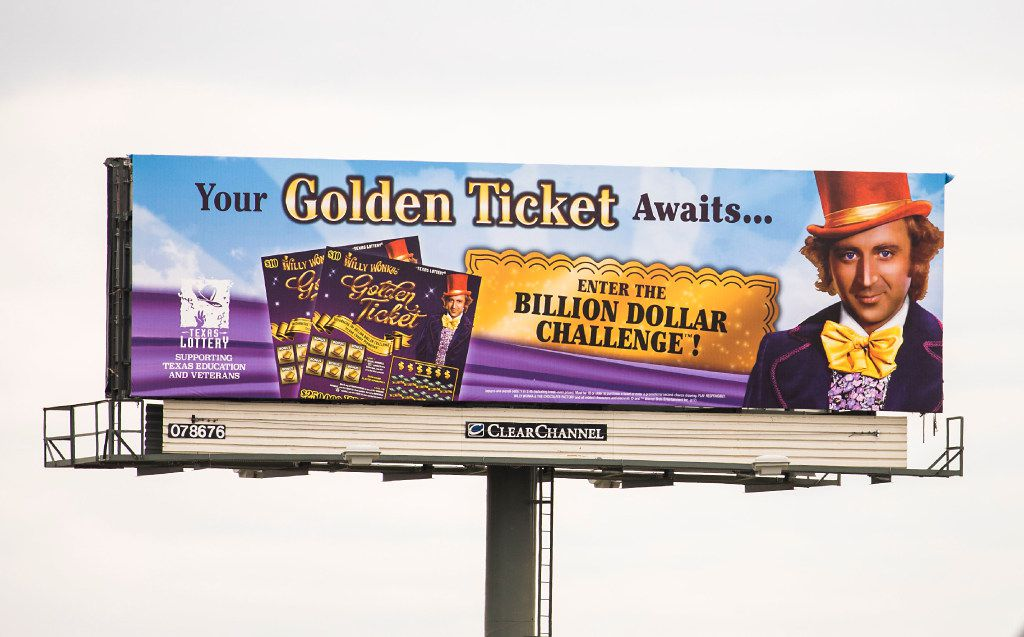 A billboard for the Texas Lottery's new Willy Wonka Golden Ticket game rises over Texas State Highway 183 ( John W. Carpenter Fwy) near Mockingbird Lane on Wednesday, April 12, 2017, in Dallas. How can the state pay $1 billion to a winner. Watchdog Dave Lieber has the answer.