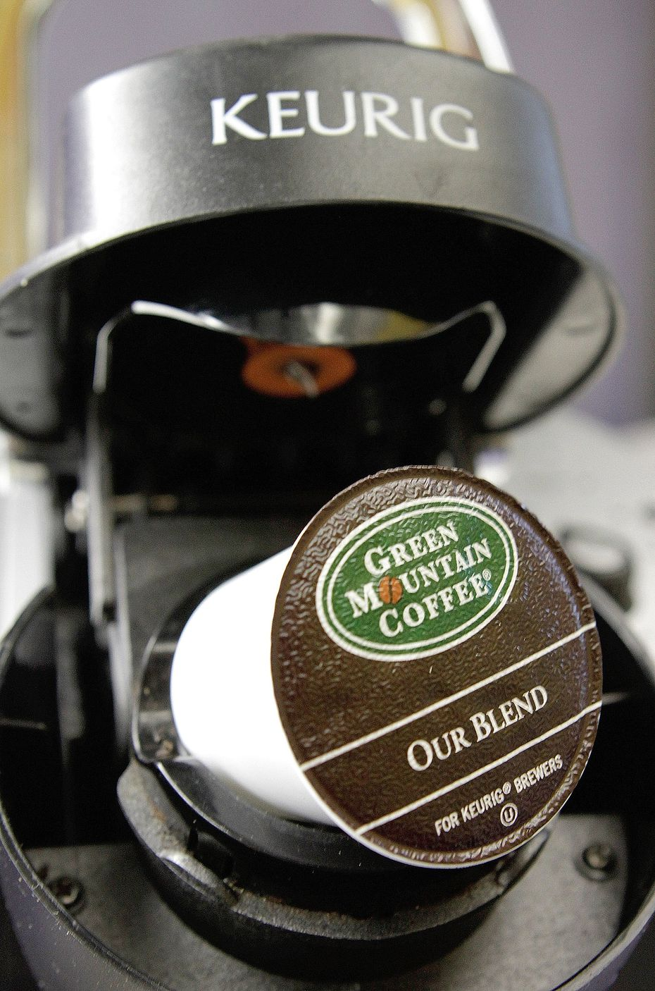 A Green Mountain Coffee single-serving brewing cup is seen in a Keurig machine.