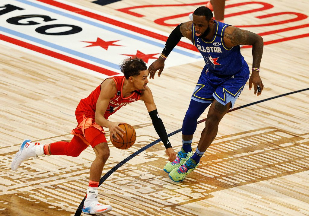 Team Giannis' Trae Young (24) drives on Team LeBron's LeBron James (2) during the second half of play in the NBA All-Star 2020 game at United Center in Chicago on Sunday, February 16, 2020. Team LeBron defeated Team Giannis 157-155. (Vernon Bryant/The Dallas Morning News)