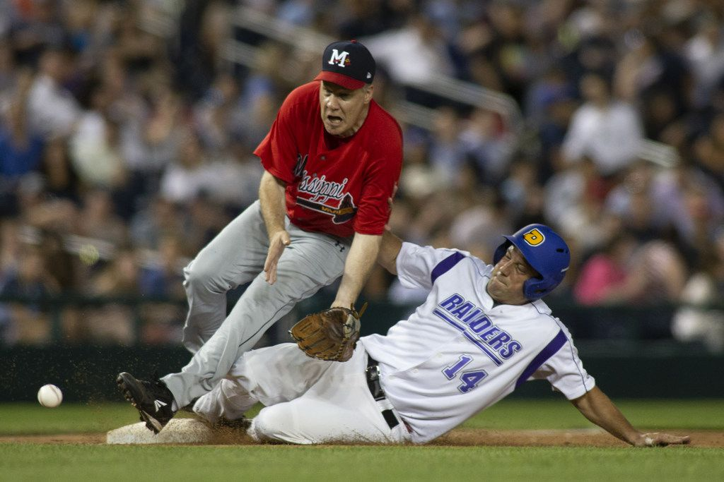 WASHINGTON, DC - JUNE 14:  Rep Tim Ryan (D-OH) (R) collides with Rep Trent Kelly (R-MI) (L) as he steals third base during the Congressional Baseball Game on June 14, 2018 in Washington, DC. This is the 57th annual game between the Republicans and Democrats. (Photo by Alex Edelman/Getty Images)