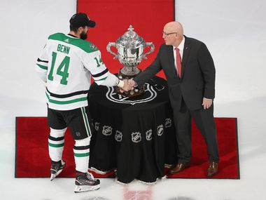 EDMONTON, ALBERTA - SEPTEMBER 14: Bill Daly, the deputy commissioner and chief legal officer of the National Hockey League (NHL) presents the Clarence S. Campbell Bowl to Dallas Stars captain Jamie Benn after winning the Western Conference Championship over the Vegas Golden Knights in Game Five during the 2020 NHL Stanley Cup Playoffs at Rogers Place on September 14, 2020 in Edmonton, Alberta, Canada.