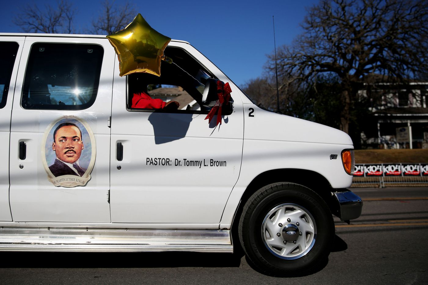 A van donning a picture of Martin Luther King, Jr. travels toward Fair Park during the 35th Annual Dr. Martin Luther King, Jr. Birthday Celebration parade.