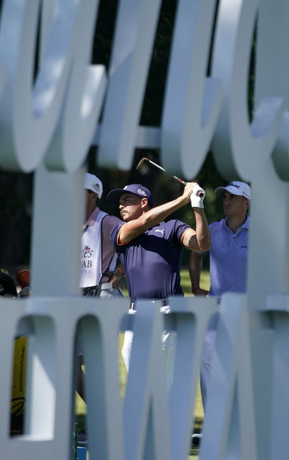 PGA Tour golfer Rickie Fowler is pictured through a large scripted sign as he tees off on No. 13. It was the opening round of the Charles Schwab Challenge at the Colonial Country Club in Fort Worth, Thursday, June 11, 2020.  The Challenge is the first tour event since the COVID-19 pandemic began. (Tom Fox/The Dallas Morning News)