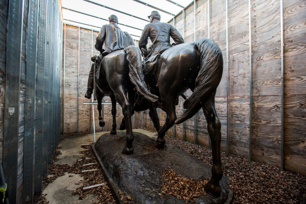 Few people have seen what became of Alexander Phimister Proctor's statue of Robert E. Lee (left) and a young soldier since its removal from the park formerly known as Lee Park,  where it stood for over 80 years until it's removal in Sept. 2017. Shortly before Christmas, on Dec. 20, 2018, The Dallas Morning News got a behind-the-scenes look the secure storage area where the statue of the Confederate general is being kept in an enclosure of plywood and metal studs, at Hensley Field, the former Naval Air Station on the west side of Mountain Creek Lake in Dallas. The statue is being kept there until its future is decided. (Ashley Landis/The Dallas Morning News)
