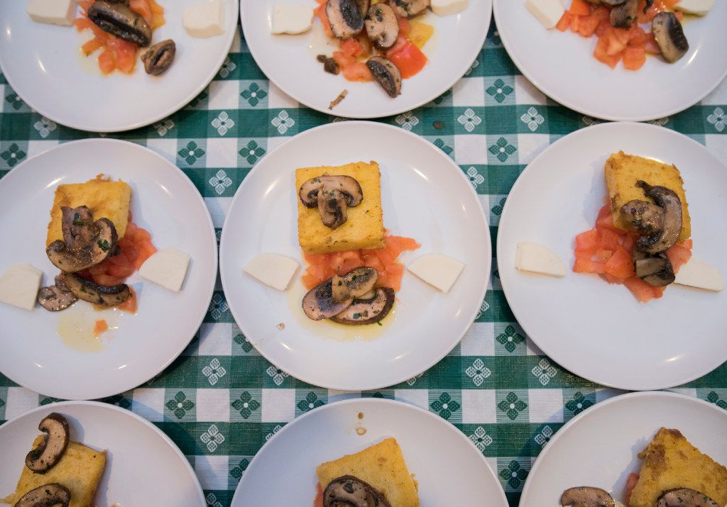 Polenta crostini with mushrooms are plated and ready to serve at the Italian Club of Dallas.