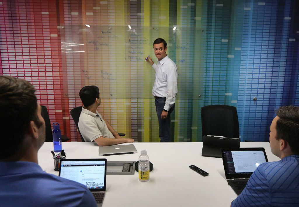 Todd Peoples, Vishal Marocha, Jack Hooper and Davis Moore, left to right, are pictured at the offices of Take Command Health in downtown Dallas. The business is a start-up founded in 2014 to help people navigate the fine print while health insurance shopping. Photographed on Tuesday, May 16, 2017. (Louis DeLuca/The Dallas Morning News)