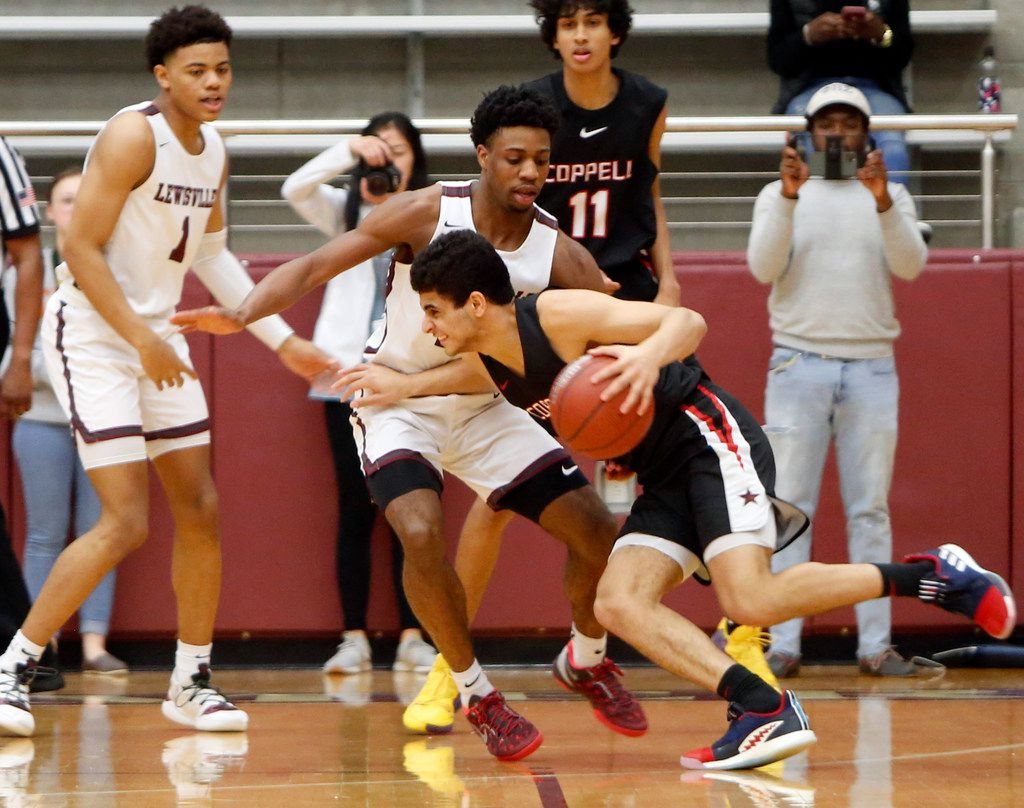 Coppell's Adam Moussa (5) found it challenging to drive the ball past the defense of Lewisville's Payton Rosenbaum (10) during first quarter action. The two teams played their District 6-6A boys basketball game at Lewisville High School in Lewisville on January 28, 2020. (Steve Hamm/ Special Contributor)