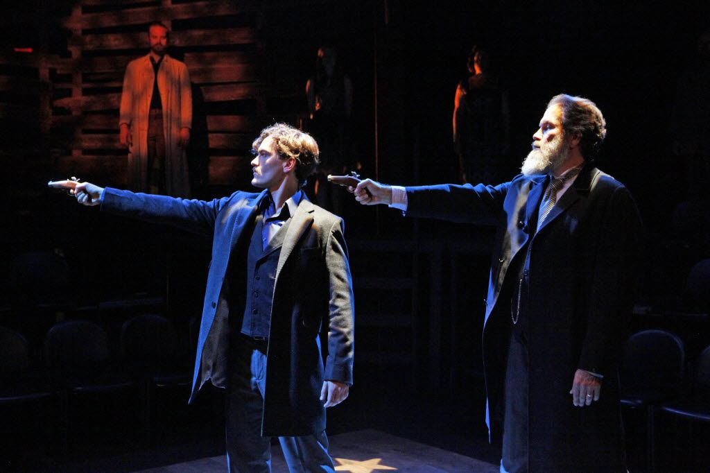 "Actor Montgomery Sutton (John Wilkes Booth), left, has a gun pointed to his head by actor Stan Denman (Edwin ""Mars"" Stanton) during a scene of the production of Booth, by Steven Walters, in May 2014 at Second Thought Theatre in Dallas."
