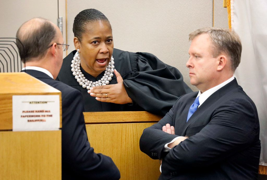 State District Judge Tammy Kemp confers with defense attorney Robert Rogers (left) and Assistant District Attorney Jason Hermus on Saturday during the murder trial of the former police officer.