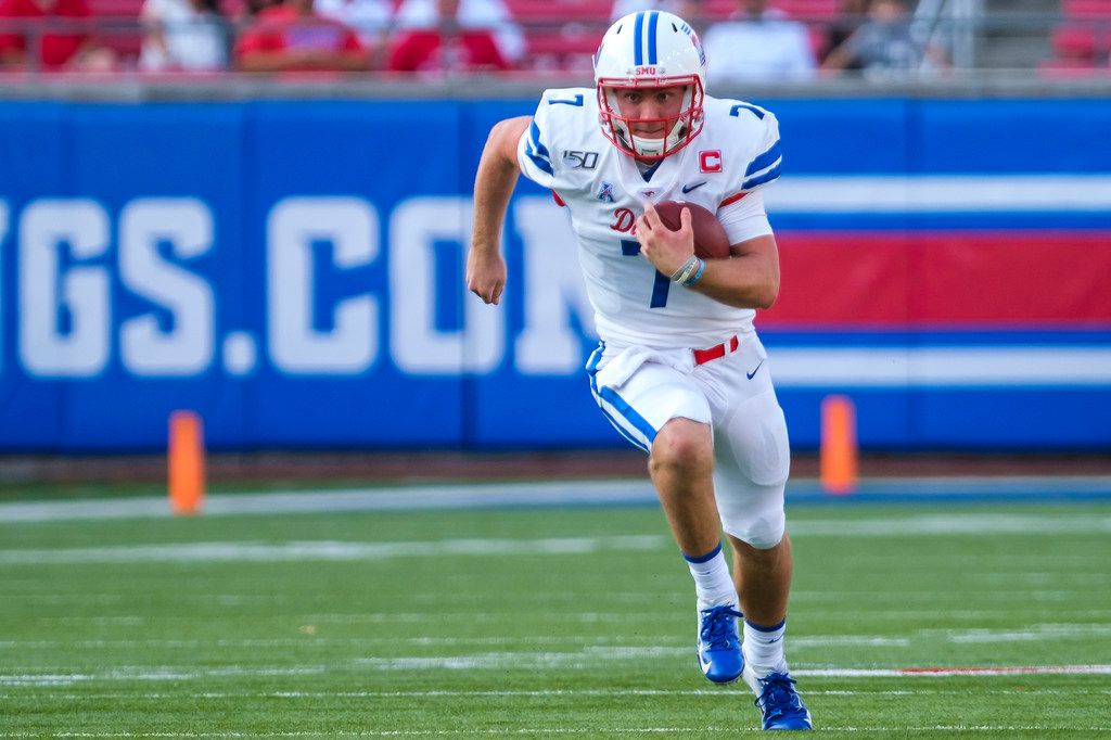SMU quarterback Shane Buechele (7) during for a first down during the first half of an NCAA football game against UNT at Ford Stadium on Saturday, Sept. 7, 2019, in Dallas.