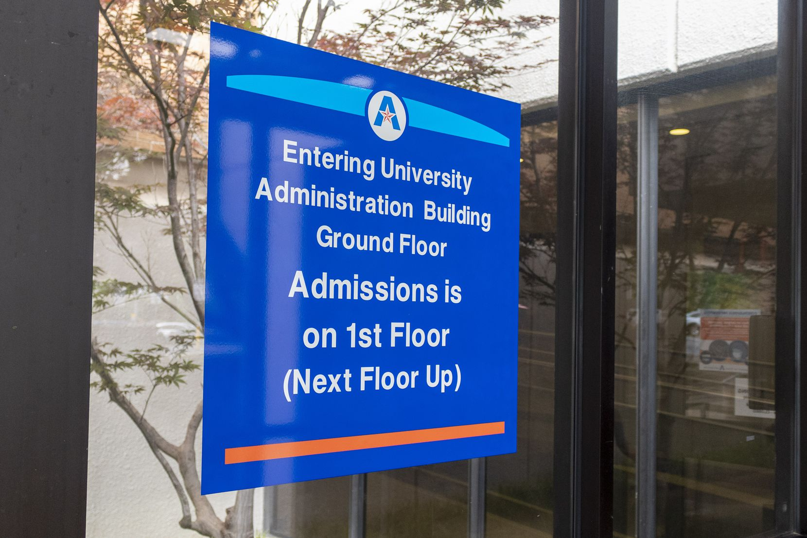 Signage displays the newly named University Administration Building, previously Davis Hall, on the campus of the University of Texas at Arlington.