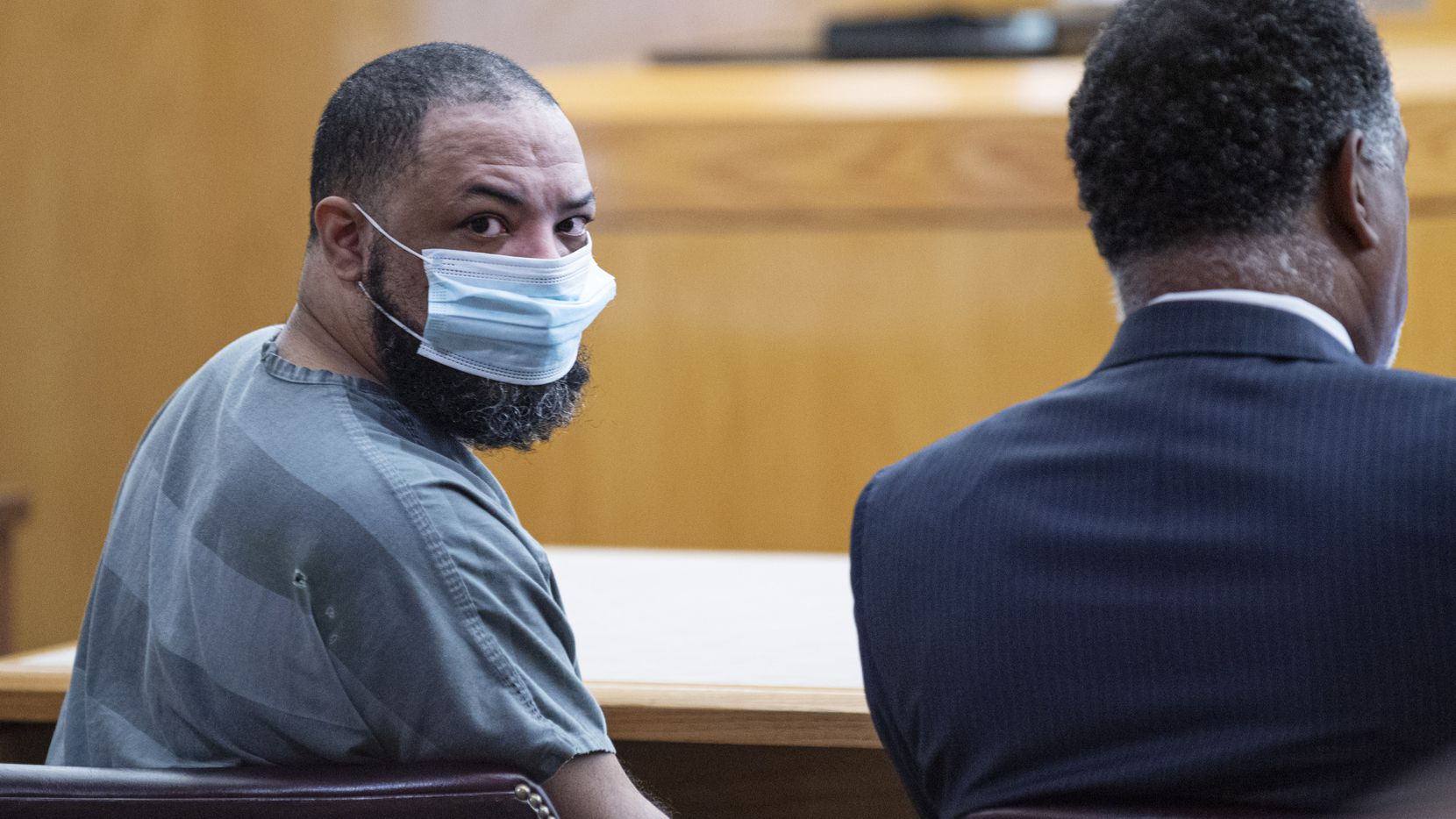 Prisoner Curtis Bullock looks over his shoulder as a witness walks into the 256th District Court to testify during Bullock's murder trial, on Thursday, July 15, 2021 at the Frank Crowley Criminal Courts Building in Dallas.