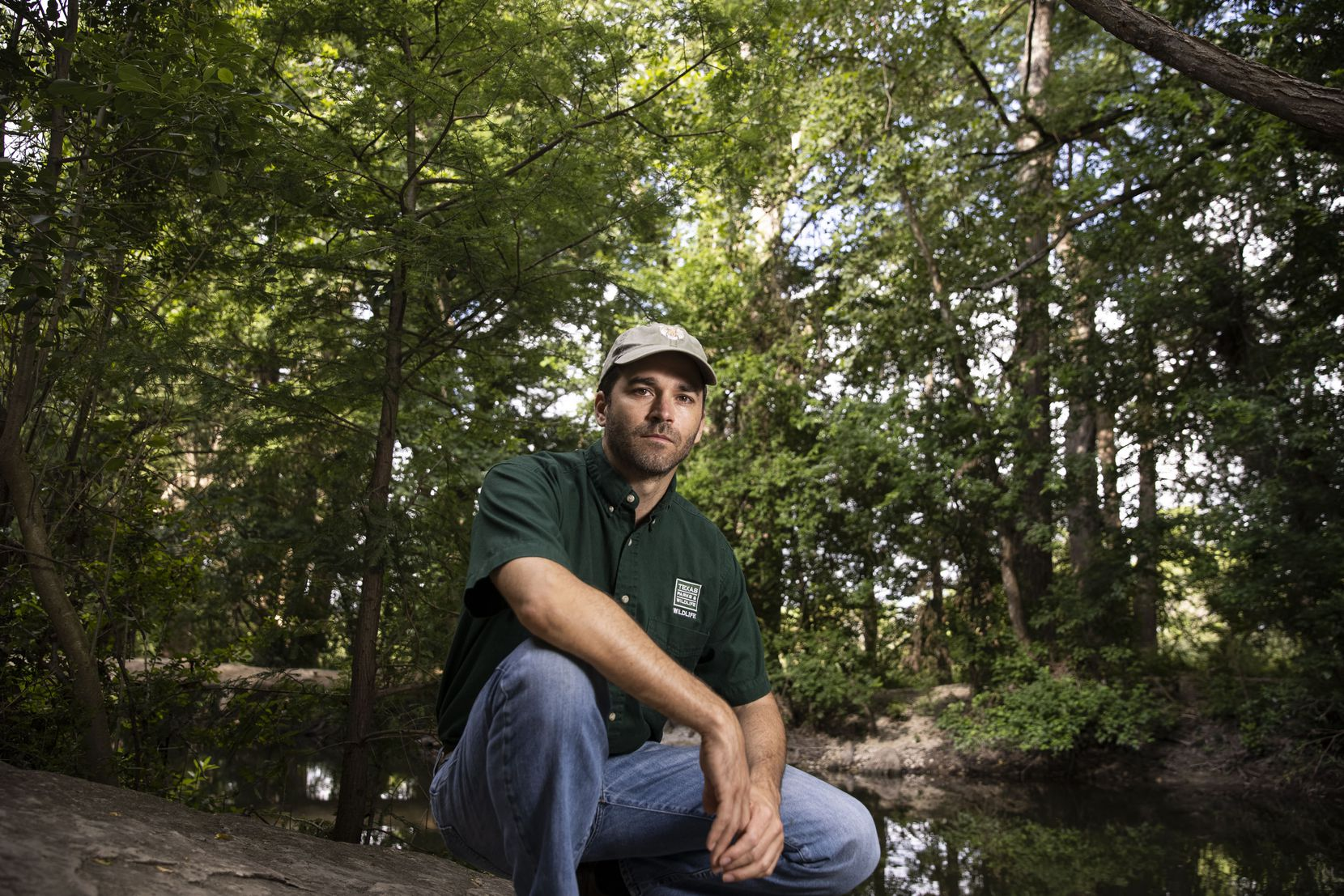Texas Park and Wildlife State Mammalogist Jonah Evans poses for a portrait at the Cibolo Nature Center in Boerne on Wednesday, June 23, 2021.