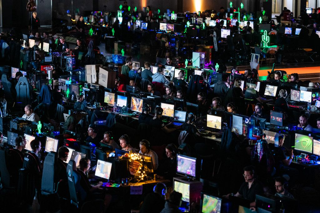 Participants sit at a computer monitor to play a video game at the 2019 DreamHack video gaming festival on February 15, 2019 in Leipzig, Germany. The three-day event brings together gaming enthusiasts, mainly from German-speaking countries, for events including eSports tournaments, cosplay contests and a LAN party with 1,500 participants.