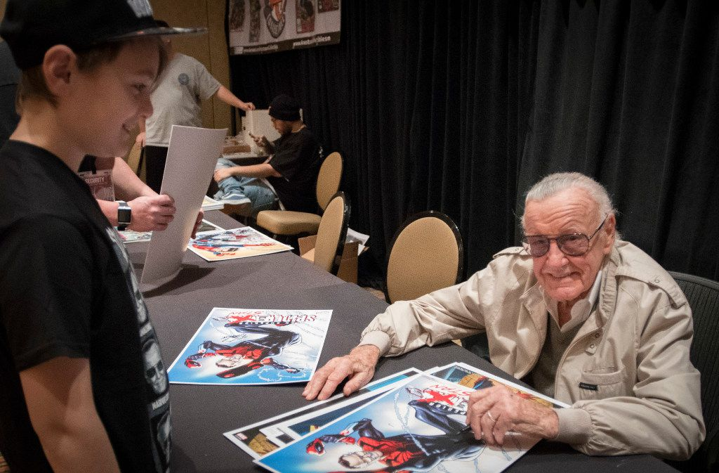 Stan Lee pauses while signing an autograph for Presley Caroll at the Marvelous Nerd Year's Eve convention on Dec. 31, 2016, at the Sheraton Hotel in Dallas. He'll be back at the end of March for Fan Expo Dallas.
