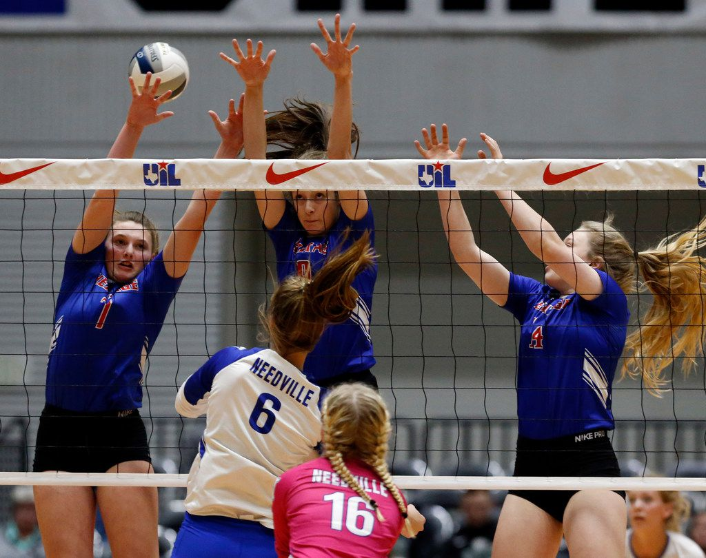 Midlothian Heritage's Saige Klor (1) , Midlothian Heritage's Hanna Larson (9)  and Grayce Davis (14) can't block a shot during the Class 4A volleyball state semifinal against Needville at the Curtis Culwell Center in Garland on Thursday, November 15, 2018. (John F. Rhodes / Special Contributor)