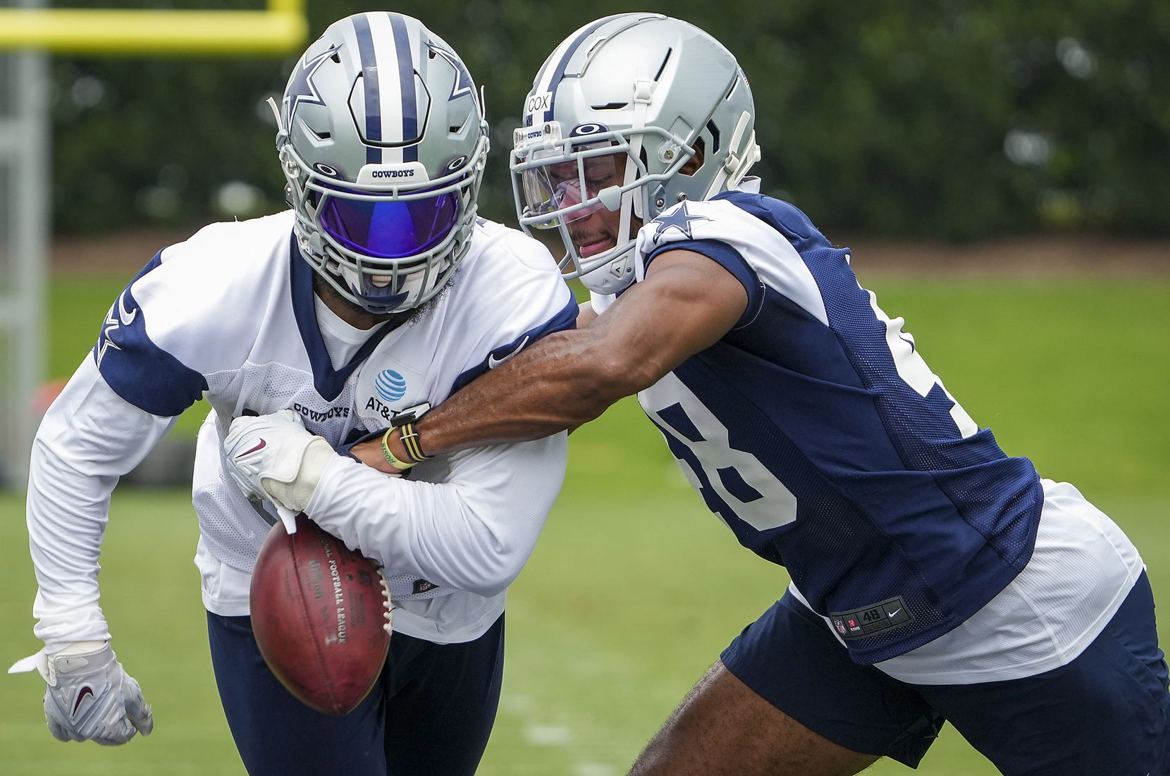 Dallas Cowboys linebacker Jabril Cox (48) knocks the ball away from running back Ezekiel Elliott (21) in drill during a minicamp practice at The Star on Wednesday, June 9, 2021, in Frisco. (Smiley N. Pool/The Dallas Morning News)