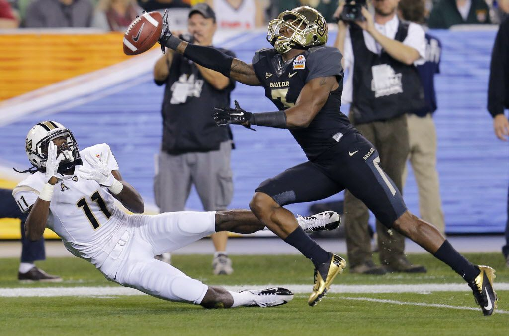 Baylor cornerback Demetri Goodson, right, breaks up a pass intended for Central Florida wide receiver Breshad Perriman during the first half of the Fiesta Bowl NCAA college football game, Wednesday, Jan. 1, 2014, in Glendale, Ariz. (AP Photo/Matt York) 01022014xSPORTS