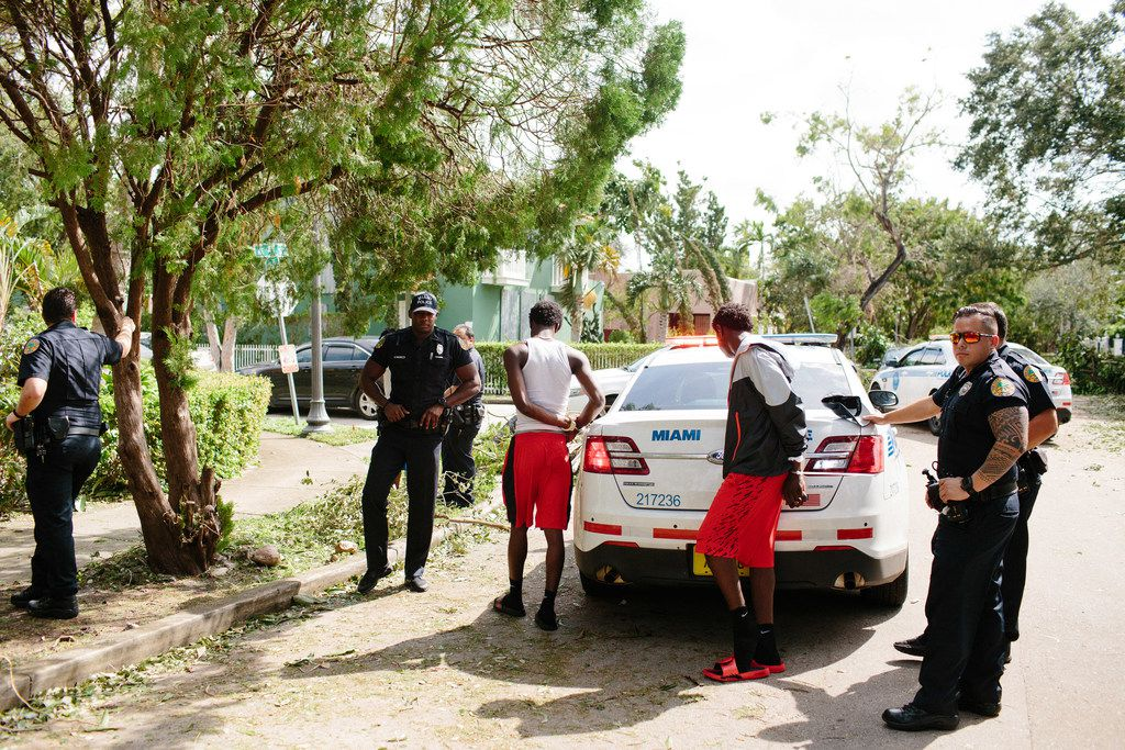 Police arrest looting suspects in the Buena Vista neighborhood of Miami on Sept. 11. About 70 percent of the city remained without electricity Monday in the wake of Hurricane Irma, and roads were not only impassable but traffic lights were not working, city officials said.