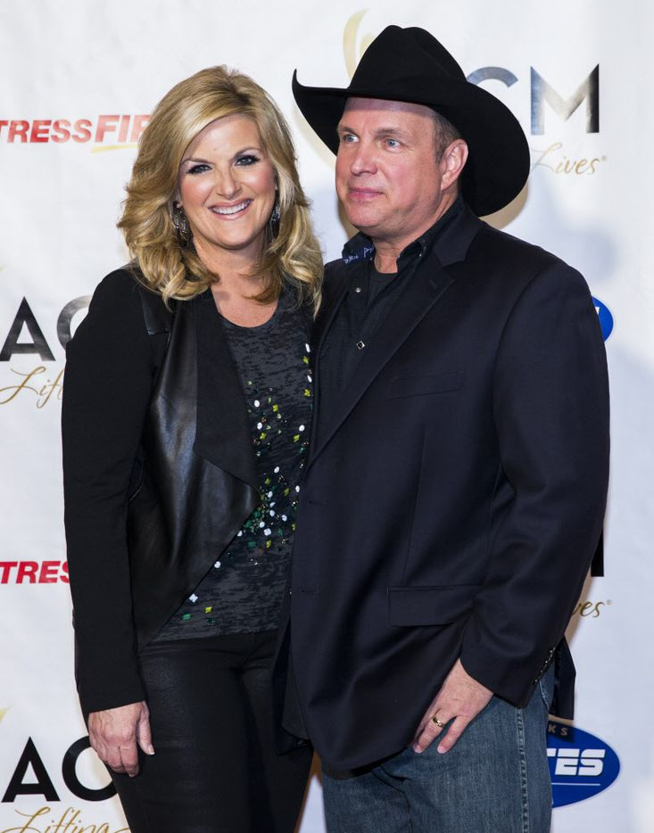 Country music stars Trisha Yearwood and Garth Brooks, who were co-hosting the ACM Lifting Lives gala, posed on the red carpet before the event Friday at the Omni Dallas hotel downtown.