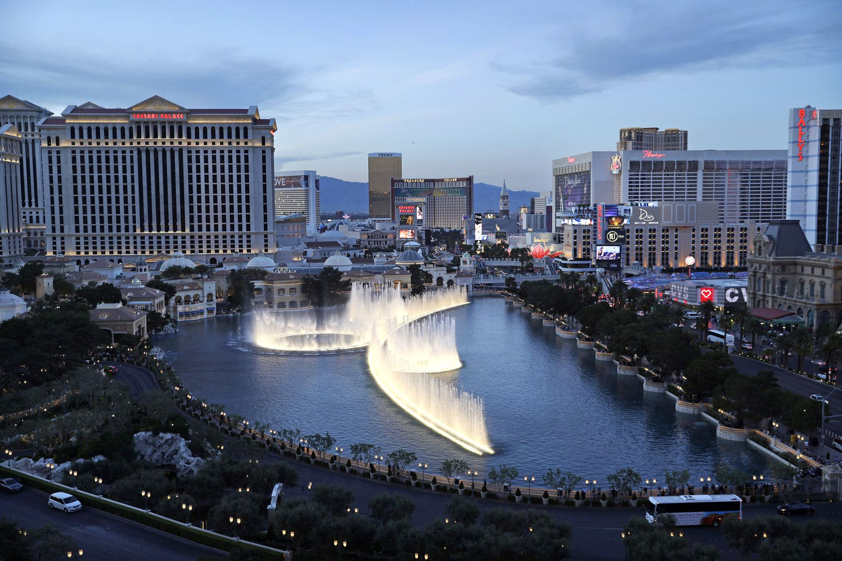 In this April 4, 2017, file photo, the fountains of Bellagio erupt along the Las Vegas Strip in Las Vegas. Pick out a good spot on the sidewalk in front of the Bellagio to catch the free dancing fountain show, which is offered several times each day -- and at night, when the Las Vegas Strip feels magical.