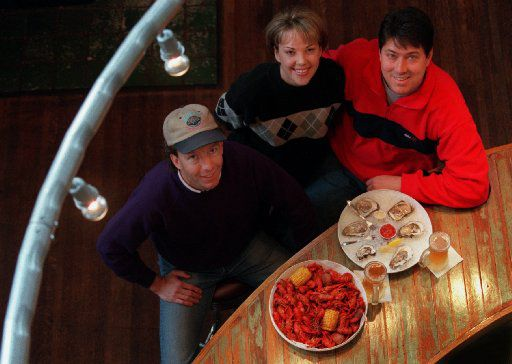In happier times, Bill Bayne, left, Michele DeWitt and her husband Randy DeWitt, were co-owners of Half Shells.