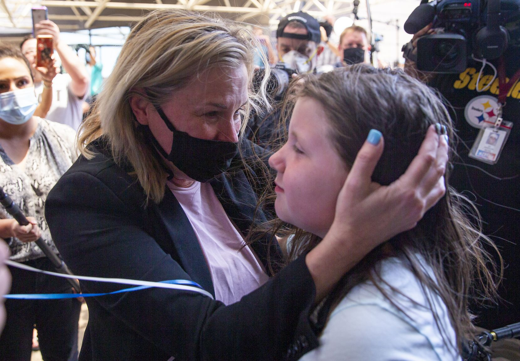 Dallas salon owner Shelley Luther hugs Savannah Holt, 10, of Garland after Luther was released from Dallas County Jail on May 7, 2020, in Dallas. The Texas Supreme Court ordered Luther's release.