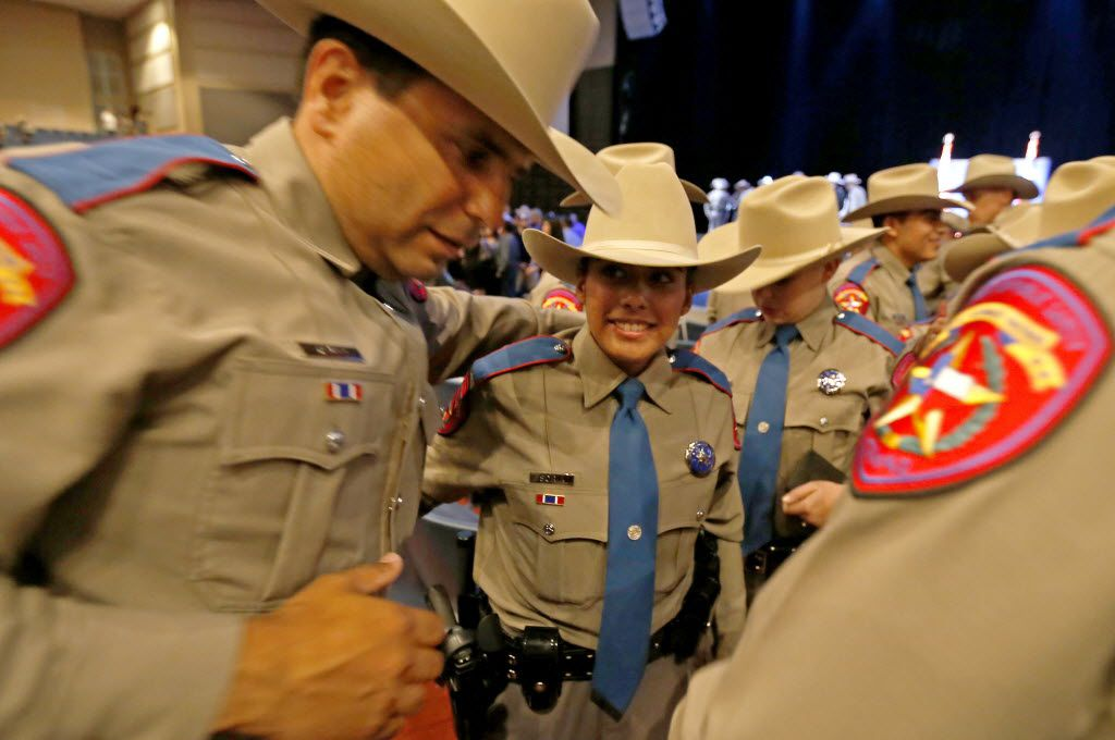 New State troopers Angel Hernandez (left) and Samantha Soria celebrate after the Texas Department of Public Safety graduation ceremony at Shoreline Christian Center on Friday, June 17, 2016, in Austin, Texas. DPS has the highest number of Hispanic trooper graduates at any time over the last decade and currently the classes of this year are about 40 percent Hispanic.