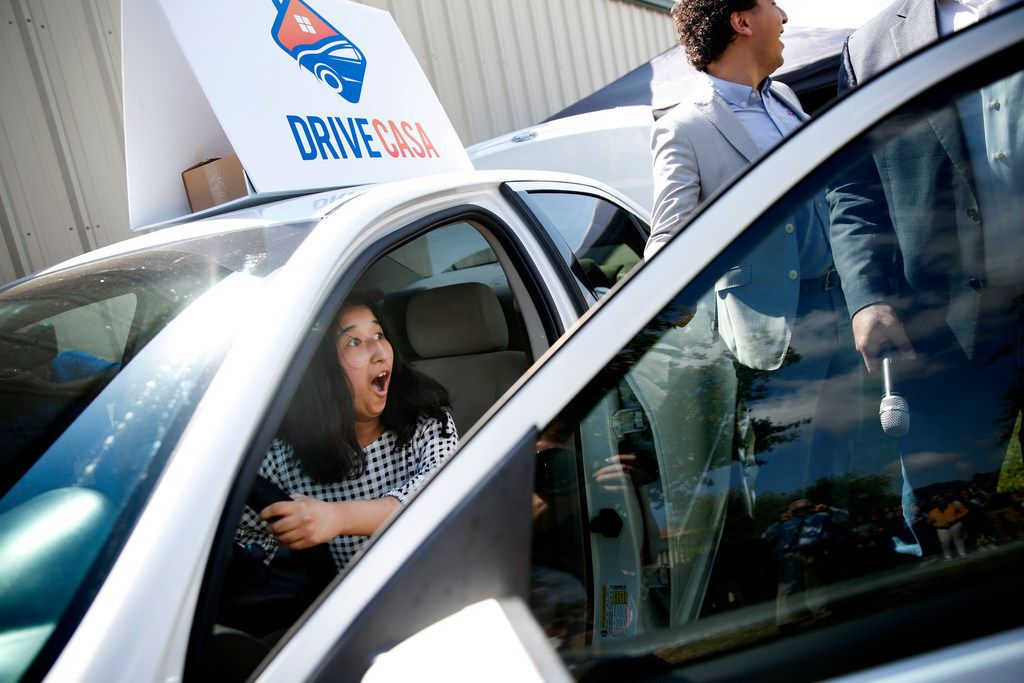 Freshman Maria Camacho reacts after winning a 2007 Ford Fusion for her perfect attendance during the school year at Faith Family Academy in Dallas on Friday, May 11, 2018. The academy partnered with local car dealership Drive Casa to offer a free car as an incentive to increase attendance. Camacho was one of five finalists for the free car. Each finalist had a chance to turn the engine and the winning key started the car. (Rose Baca/The Dallas Morning News)