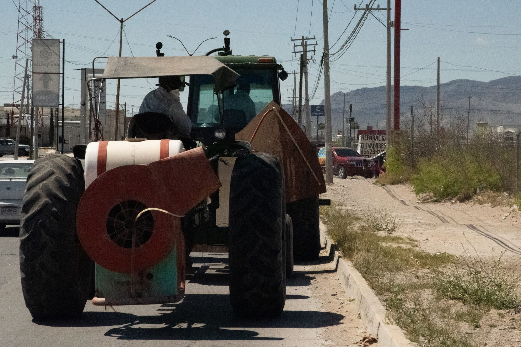 Tractors being led and followed by police vehicles sprayed the grounds Tuesday around the Mexican Institute of Social Security's hospital #66 in Ciudad Juarez.