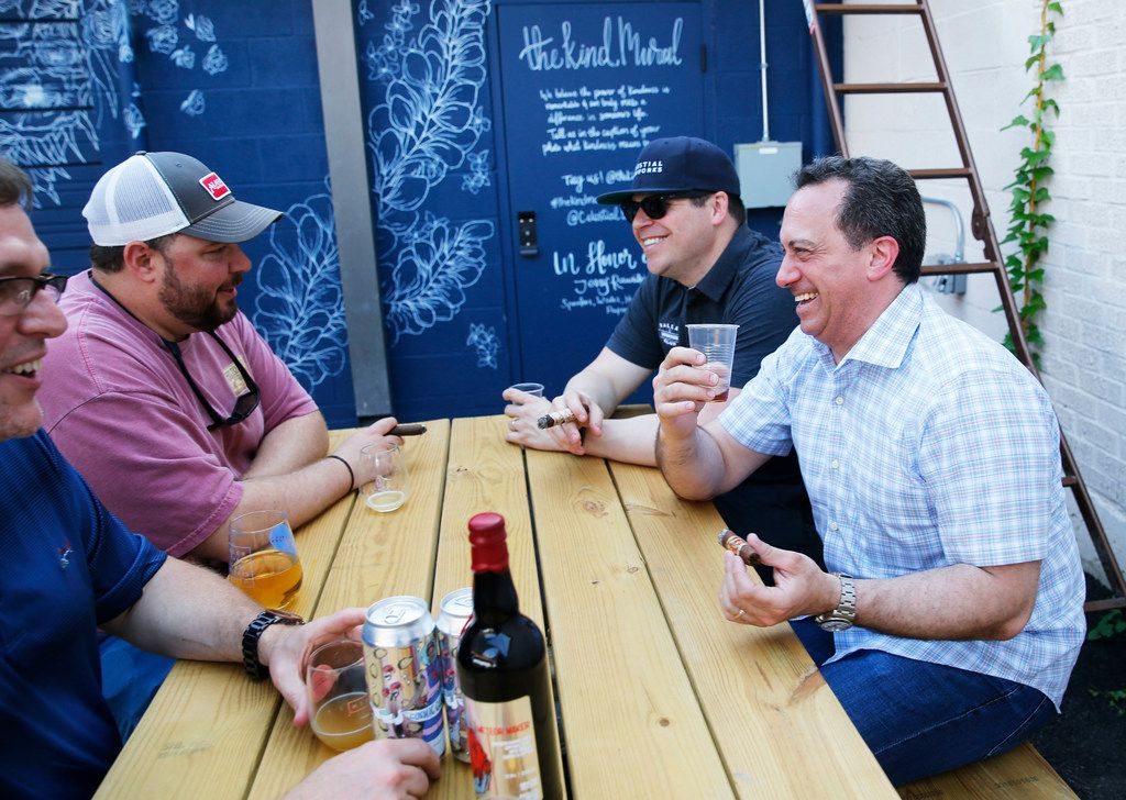 Dallas Bourbon Club members Dave Parks (left) of Irving, Josh Snider (second from left) of Flower Mound, Dallas Bourbon Club president, Brian Lowe (left) of Dallas and fellow member Ross Parker of  Dallas share a laugh during the Meteor Maker release party at Celestial Beerworks in Dallas, on Friday, May 24, 2019. Dallas Bourbon Club teamed up with Celestial Beerworks by getting Celestial Beerworks to age a beer in a Maker's Mark wooden barrel for Meteor Maker. Meteor Maker, a Maker's Mark Private Select barrell-aged imperial stout brewed with vanilla, lactose and coffee. (Vernon Bryant/The Dallas Morning News)
