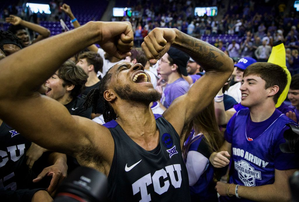 TCU Horned Frogs guard PJ Fuller (4) celebrates after fans rush the court because of a 75-72 win over Baylor on Saturday, February 29, 2020 at Ed & Rae Schollmaier Arena on the TCU campus in Fort Worth. (Ashley Landis/The Dallas Morning News)