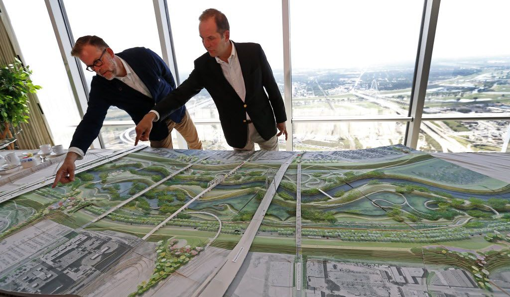 Brent Brown (left), architect and founding director of BC Workshop and Dallas CityDesign Studio, and Matthew Urbanski, principal of Michael Van Valkenburgh Associates, answer questions about details of the Trinity River Park plan on a model at the City Club in Dallas, Thursday, May 19, 2016. (Jae S. Lee/The Dallas Morning News)
