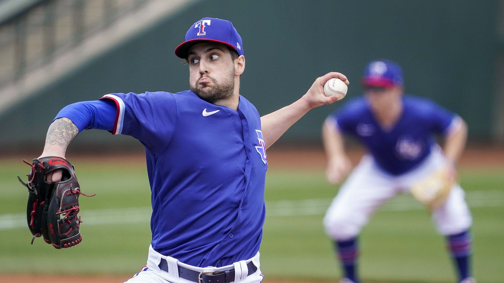 Texas Rangers pitcher Joe Palumbo delivers during the first inning of a spring training game against the San Diego Padres at Surprise Stadium on Thursday, March 4, 2021, in Surprise, Ariz.