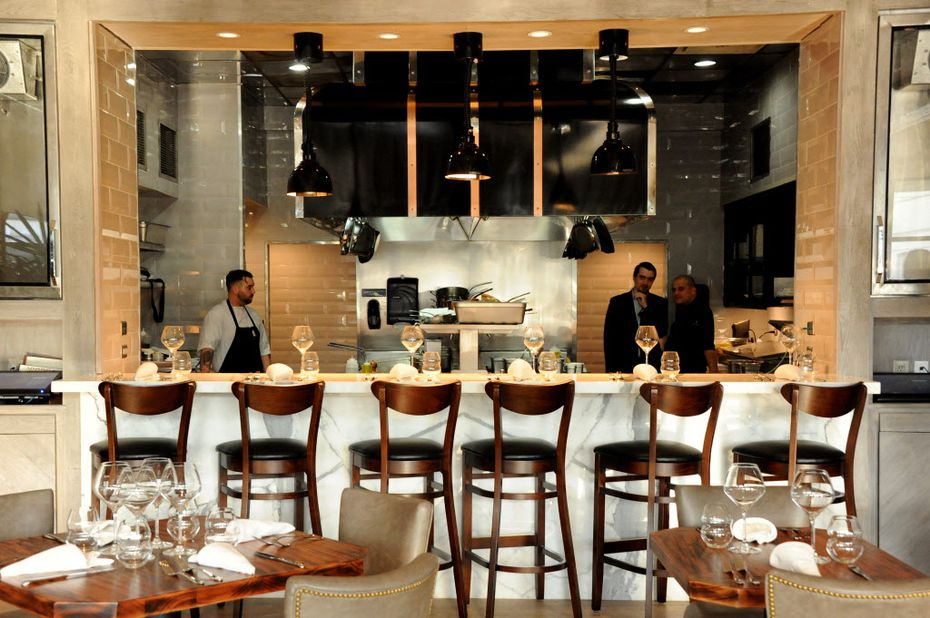 The chef's table, which looks into the kitchen, seats six.