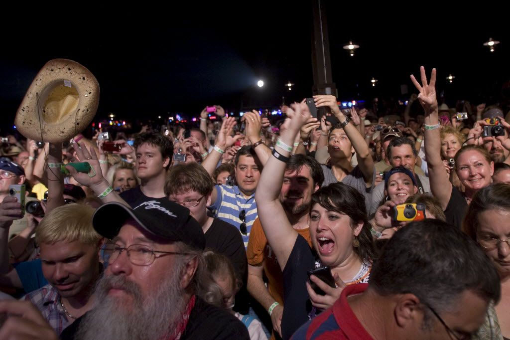 Fans cheer as Willie Nelson takes the stage at Billy Bob's Texas in Fort Worth on July 4, 2011 during Willie's Picnic and Country Throwdown.