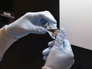 A vial of the investigational drug remdesivir is visually inspected at a Gilead manufacturing site in the United States.