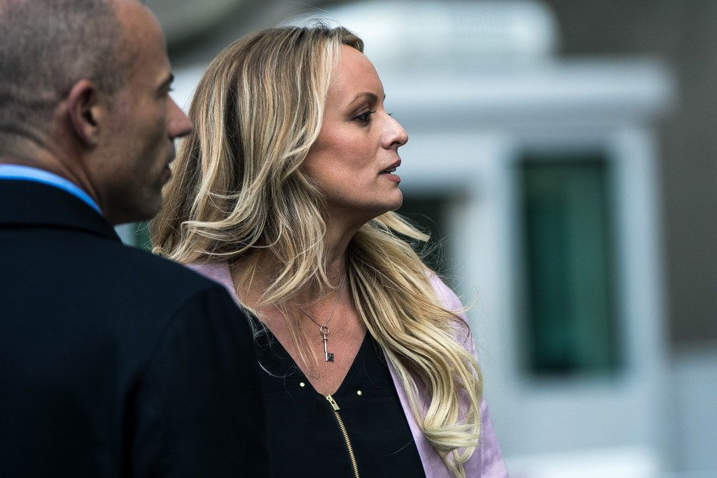 Adult film star Stormy Daniels, who's real name is Stephanie Clifford,  and with her attorney, Michael Avenatti,  leave federal court in Manhattan following a hearing involving Michael Cohen, President Donald Trump's longtime personal lawyer.