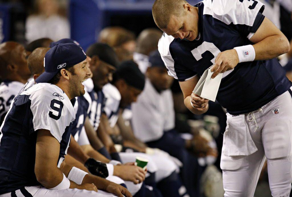 Dallas Cowboys quarterback Tony Romo (9) and quarterback Jon Kitna joke on the bench during the second half Dallas' 24-7 win over the Oakland Raiders Thursday, November 26, 2009 at Cowboys Stadium in Arlington. (G.J. McCarthy/The Dallas Morning News)