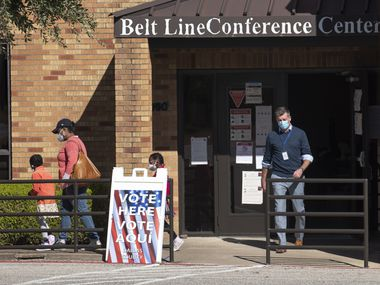 Voters walk out of the Belt Line Conference Center in DeSoto after casting their ballot in the 2020 election, on Tuesday, Nov. 3, 2020.