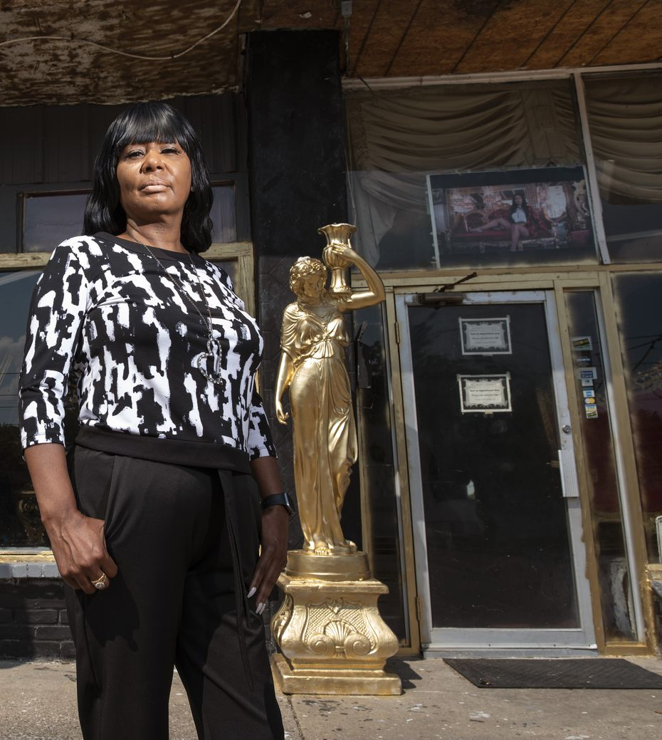 Yolanda McGriff stands outside her business, McGriff's Antiques and Imports, in southern Dallas.