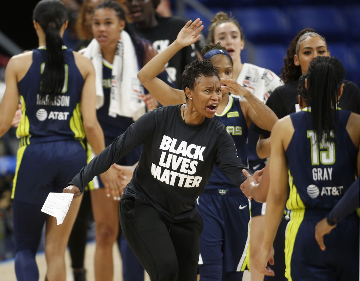 Dallas Wings head coach Vickie Johnson enthusiastically greets her players as they head to the team bench for a called time-out during the first quarter of play against the Minnesota Lynx. The two teams played their WNBA game at College Park Center on the campus of the University of Arlington on June 17, 2021(Steve Hamm/ Special Contributor)