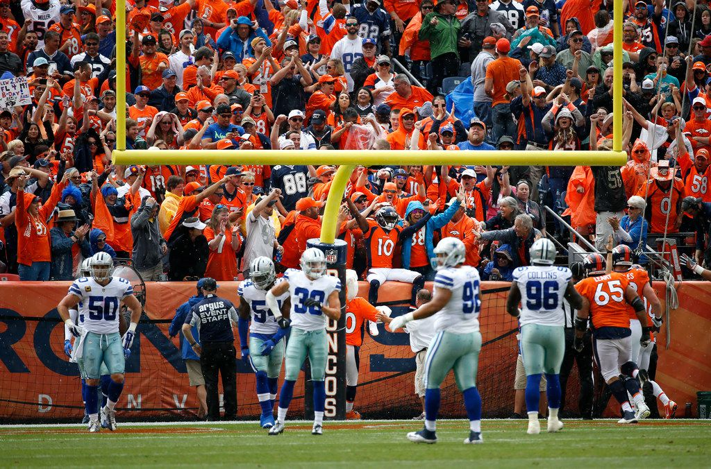 Denver Broncos wide receiver Emmanuel Sanders (10, sitting on wall, center, behind the uprights) celebrates with fans in the end zone after scoring a touchdown in the first quarter at Sports Authority Field at Mile High Stadium in Denver, Colorado on Sunday, Sept. 17, 2017. (Rose Baca/The Dallas Morning News)