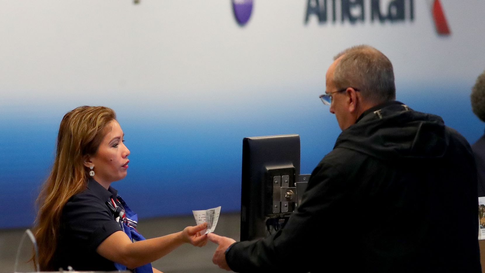DALLAS, TEXAS - MARCH 13: A passenger checks in for an American Airlines in Terminal D at Dallas/Fort Worth International Airport (DFW) on March 13, 2020 in Dallas, Texas. American Airlines announced that it is cutting a third of its international flights amid a major slowdown due to the Coronavirus (COVID-19) outbreak. (Photo by Tom Pennington/Getty Images)