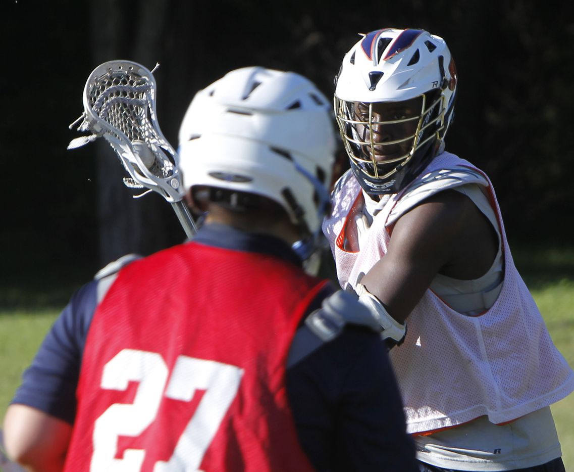 G' Colby Spivey maintains sharp focus as he runs through a drill during a practice session for members of the Bridge Eagles lacrosse team. The Bridge lacrosse team held their Wednesday evening practice session at the JC Phelps Recreation Center in Dallas on May 5, 2021.