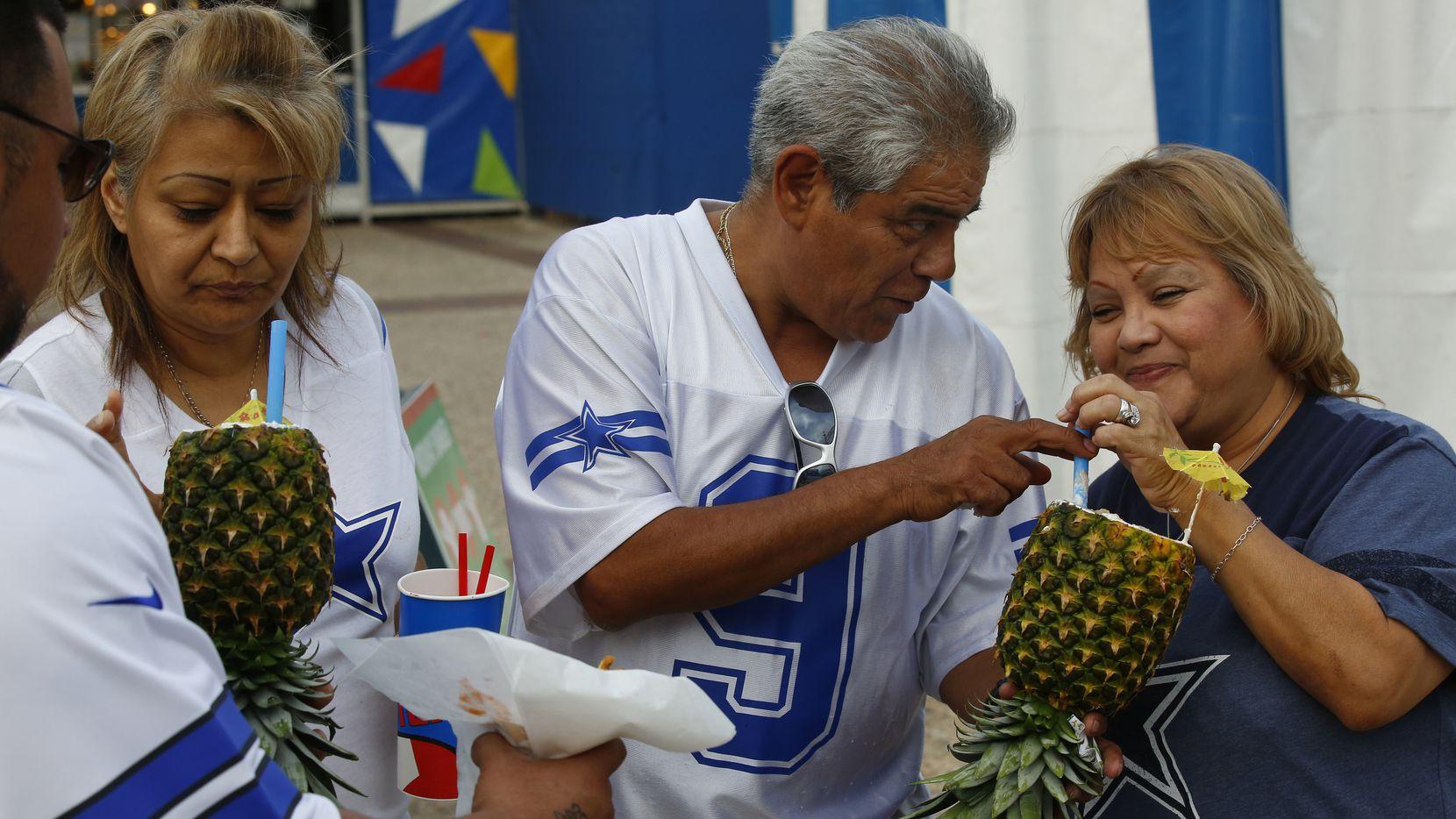 In this 2014 file photo, Roberto Aguilar (left to right) Lydia Aguilar, Ralph Delgado and Mary Delgado enjoy Pina Colada Smoothies at the State Fair of Texas.