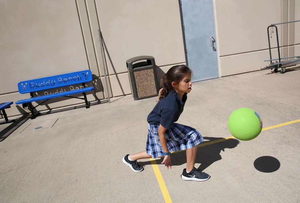 Fourth-grader Elisheva Wider plays near the Buddy Benches at Akiba Academy in North Dallas.