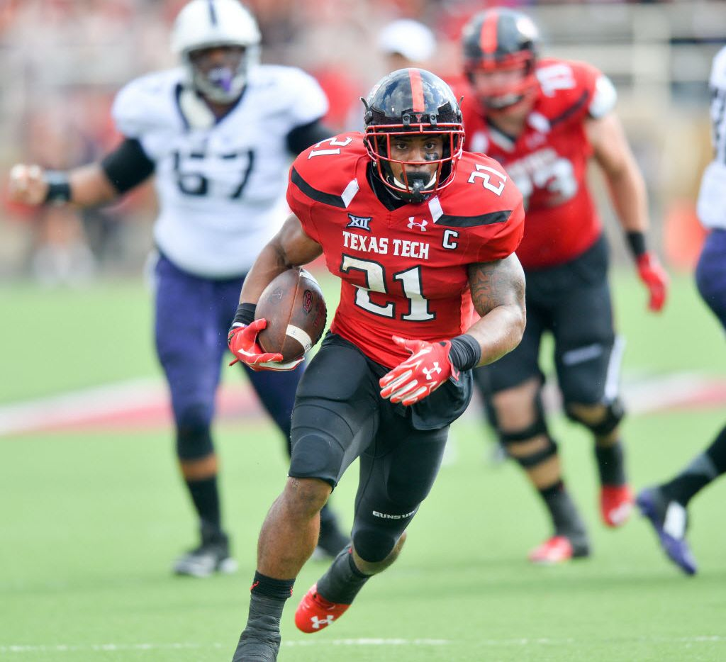 LUBBOCK, TX - SEPTEMBER 26: DeAndre Washington #21 of the Texas Tech Red Raiders runs the ball for yardage against the TCU Horned Frogs on September 26, 2015 at Jones AT&T Stadium in Lubbock, Texas. TCU won the game 55-52. Photo by John Weast/Getty Images)