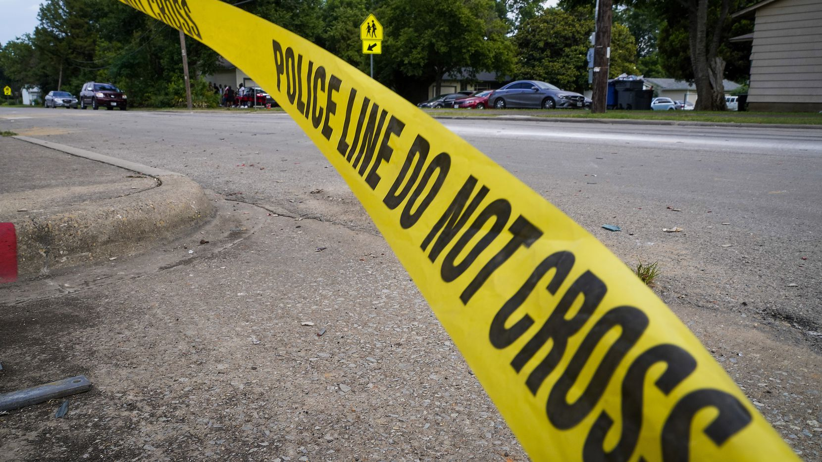Police tape flutters at the scene scene of a shooting in the 8300 block of Towns Street earlier this month.
