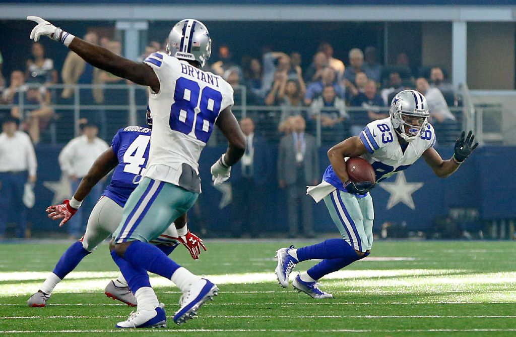 Cowboys wide receiver Dez Bryant (88) points for wide receiver Terrance Williams (83) to run out of bounds in the final seconds of their game against the New York Giants at AT&T Stadium in Arlington, Texas, Sunday, September 11, 2016. Time expired after the tackle as the Cowboys lost, 20-19.